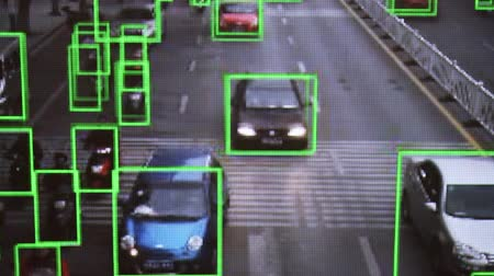 terrorista : CCTV camera. Real-time tracking of vehicles and people on the street. Authentic pixelated image from a real monitor.