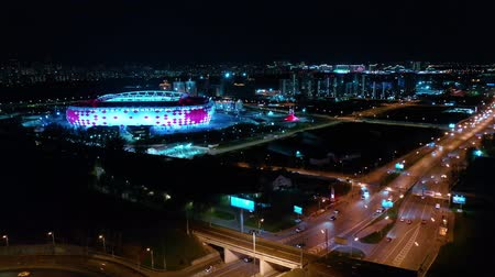multiple lane : Night Aerial view of a freeway intersection and football stadium Spartak Moscow Otkritie Arena