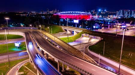 államközi : Night Timelapse Aerial view of a freeway intersection traffic trails in night Moscow Stock mozgókép