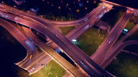 közvetlenül : Night Aerial view of a freeway intersection traffic trails in night Moscow