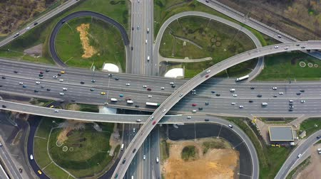 közvetlenül : Aerial view of a freeway intersection traffic trails in Moscow.