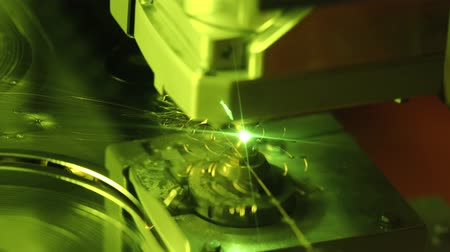 gravura : CNC Laser cutting of metal modern industrial technology. Laser cutting works by directing the output of a high-power laser through optics. Laser optics and CNC computer numerical control. Vídeos