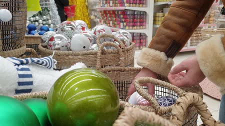 time year : Selection and Shopping in the store for Christmas decorations for the Christmas tree. Stock Footage