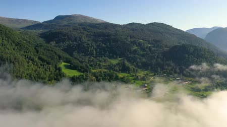 dron : Aerial footage Beautiful Nature Norway over the clouds.