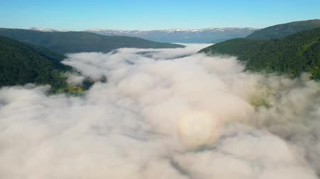 Скандинавия : Aerial footage Beautiful Nature Norway over the clouds.
