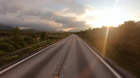 realtime : Driving a Car on a Road in Norway at dawn