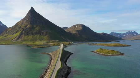 takımadalar : Fredvang Bridges Lofoten islands is an archipelago in the county of Nordland, Norway. Is known for a distinctive scenery with dramatic mountains and peaks, open sea and sheltered bays.