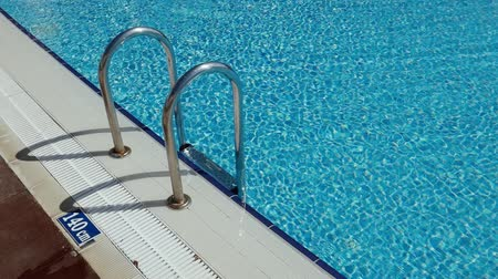 megragad : Grab bars ladder in the swimming pool