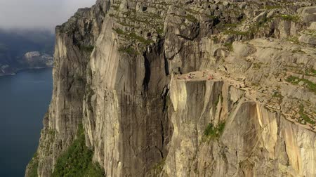 plateau : Aerial footage Preikestolen or Prekestolen, also known by the English translations of Preachers Pulpit or Pulpit Rock, is a famous tourist attraction in Forsand, Ryfylke, Norway Stock Footage