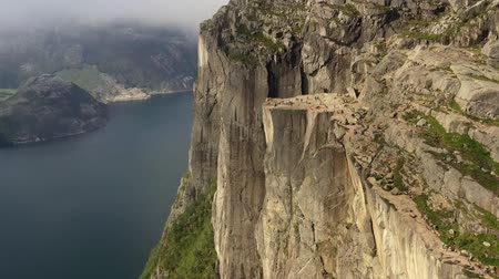 planalto : Aerial footage Preikestolen or Prekestolen, also known by the English translations of Preachers Pulpit or Pulpit Rock, is a famous tourist attraction in Forsand, Ryfylke, Norway Stock Footage