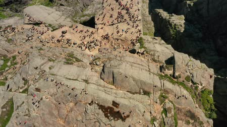 extreme : Aerial footage Preikestolen or Prekestolen, also known by the English translations of Preachers Pulpit or Pulpit Rock, is a famous tourist attraction in Forsand, Ryfylke, Norway Stock Footage