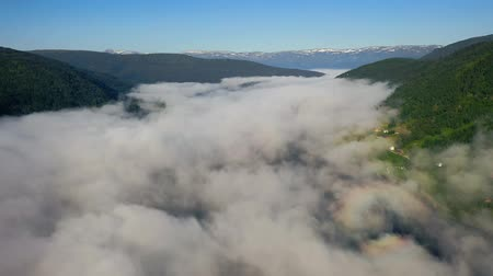 fiorde : Aerial footage Beautiful Nature Norway over the clouds.