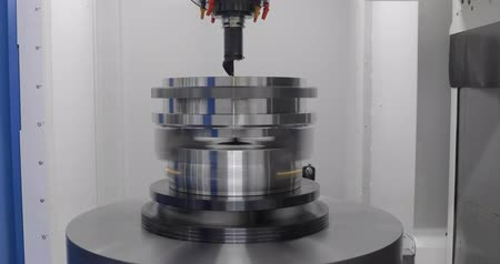 área de trabalho : Metalworking CNC lathe milling machine. Cutting metal modern processing technology. Milling is the process of machining using rotary cutters to remove material by advancing a cutter into a workpiece.