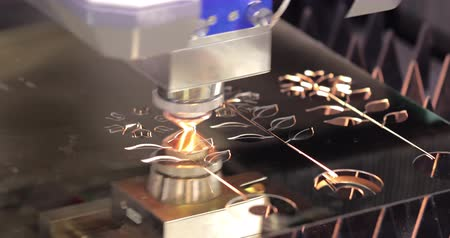 fotokopi makinesi : CNC Laser cutting of metal modern industrial technology. Laser cutting works by directing the output of a high-power laser through optics. Laser optics and CNC computer numerical control. Stok Video