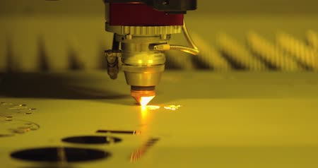 激しい : CNC Laser cutting of metal modern industrial technology. Laser cutting works by directing the output of a high-power laser through optics. Laser optics and CNC computer numerical control. 動画素材