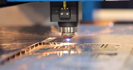 laser engraving : CNC Laser cutting of metal modern industrial technology. Laser cutting works by directing the output of a high-power laser through optics. Laser optics and CNC computer numerical control. Stock Footage