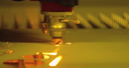 grawerowanie : CNC Laser cutting of metal modern industrial technology. Laser cutting works by directing the output of a high-power laser through optics. Laser optics and CNC computer numerical control. Wideo