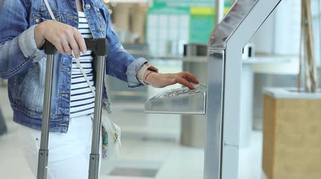 ticket machine : Female Traveller check-in at self help desk in the airport