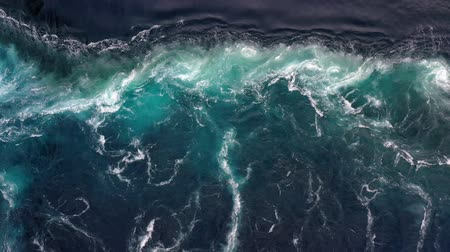 whirling : Waves of water of the river and the sea meet each other during high tide and low tide. Whirlpools of the maelstrom of Saltstraumen, Nordland, Norway
