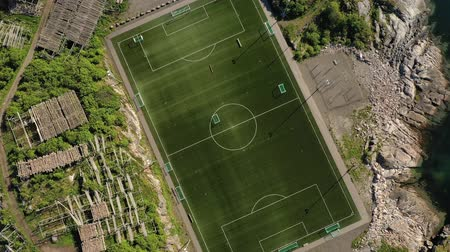 архипелаг : Norway Lofoten Football field stadium in Henningsvaer from above.