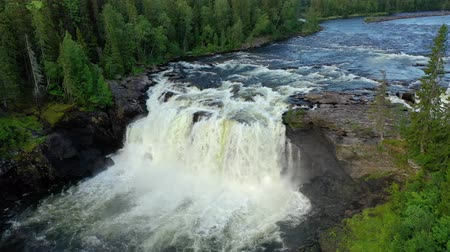 füstös : Ristafallet waterfall in the western part of Jamtland is listed as one of the most beautiful waterfalls in Sweden. Stock mozgókép
