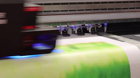 impressão digital : Industrial sublimation printer for digital printing on fabrics. Modern textile industry. Textile printing is the process of applying colour to fabric in definite patterns or designs. Stock Footage