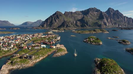 sail rock : Henningsvaer Lofoten is an archipelago in the county of Nordland, Norway. Is known for a distinctive scenery with dramatic mountains and peaks, open sea and sheltered bays, beaches and untouched lands Stock Footage