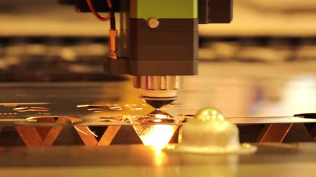 гравюра : CNC Laser cutting of metal modern industrial technology. Laser cutting works by directing the output of a high-power laser through optics. Laser optics and CNC computer numerical control. Стоковые видеозаписи