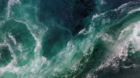 swirling : Waves of water of the river and the sea meet each other during high tide and low tide. Whirlpools of the maelstrom of Saltstraumen, Nordland, Norway