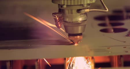 gravure : CNC Laser cutting of metal modern industrial technology. Laser cutting works by directing the output of a high-power laser through optics. Laser optics and CNC computer numerical control. Stockvideo