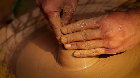 clay pot : Potter at work makes ceramic dishes. India, Rajasthan.