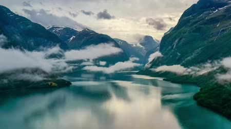 geiranger : Beautiful Nature Norway natural landscape lovatnet lake flying over the clouds.