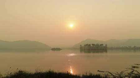 architectural heritage : Jal Mahal (meaning Water Palace) is a palace in the middle of the Man Sagar Lake in Jaipur city, the capital of the state of Rajasthan, India. Stock Footage