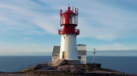 north bay : Lindesnes Lighthouse is a coastal lighthouse at the southernmost tip of Norway. The light comes from a first order Fresnel lens that can be seen for up to 17 nautical miles Stock Footage