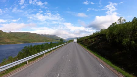 Норвегия : Vehicle point-of-view Driving a Car VR Caravan travels on the highway. Tourism vacation and traveling. Beautiful Nature Norway natural landscape.