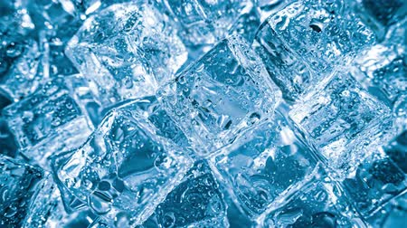 冬 : Ice cubes closeup, abstract background.
