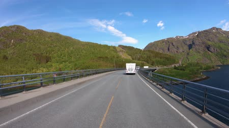 hegytömb : Vehicle point-of-view Driving a Car VR Caravan travels on the highway. Tourism vacation and traveling. Beautiful Nature Norway natural landscape.