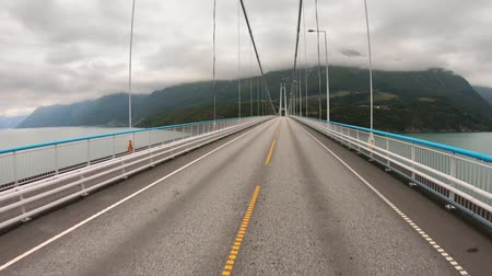 realtime : Driving a Car on a Road in Norway. Vehicle point-of-view driving over the bridge.