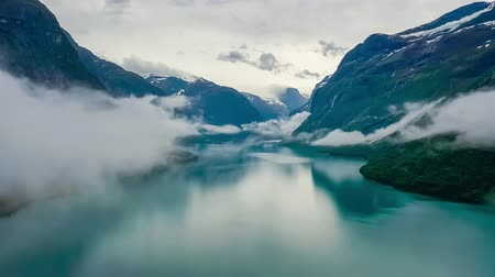 fiordos : Beautiful Nature Norway natural landscape lovatnet lake flying over the clouds.