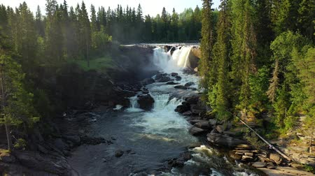arco : Ristafallet waterfall in the western part of Jamtland is listed as one of the most beautiful waterfalls in Sweden. Stock Footage
