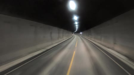 drive through : Car rides through the tunnel point-of-view driving