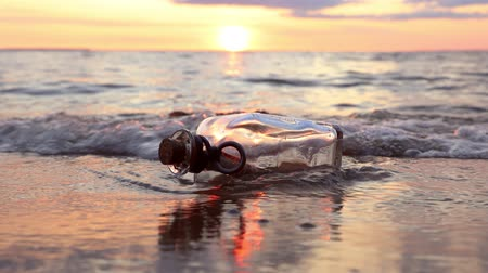buried : Message in the bottle against the Sun setting down