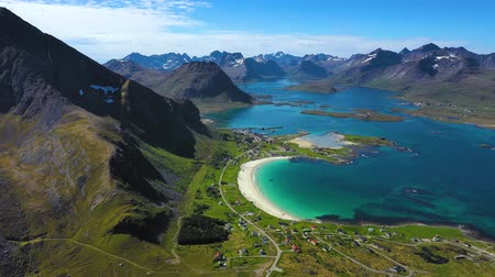 Beach Lofoten islands is an archipelago in the county of Nordland, Norway. Is known for a distinctive scenery with dramatic mountains and peaks, open sea and sheltered bays, beaches Стоковые видеозаписи