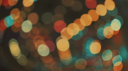 Abstract colorful blurry moving Bokeh of decorate light of carousel ride in Amusement