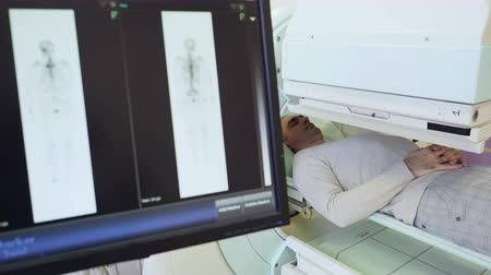 radiation therapy : Technical review of person with magnet for x-ray prognosis injury. Professional occupation and ct examining for image for doctor. Action for prevention and therapy of illness of bone of human