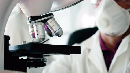 scrutiny : Concept of clinical expertise close up. Old male person discovery materials use the innovation microscope. Chemist tester work in laboratory, checking analysis of blood and create new vaccination