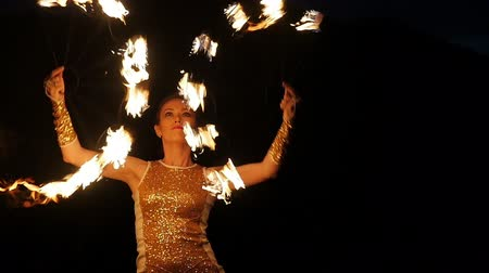 tudo : Amazing art action at open air. Attractive girl model juggling igniting sparkling torches slowmotion. Actress entertaining tourists, twilight spectacle in amphitheater. Program in all inclusive tour
