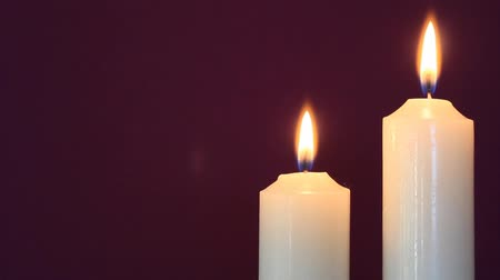 gyertyák : Two Candles burning on a Purple Background