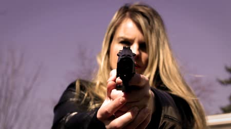 владелец : Female Secret Agent aims pistol at camera V2   Action Movie Shots