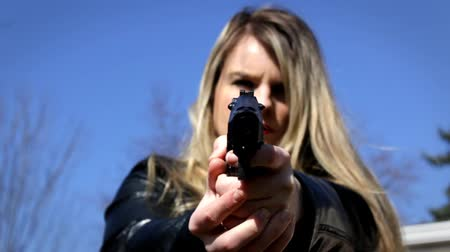 amendment : Female Secret Agent aims pistol at camera    Action Movie Shots